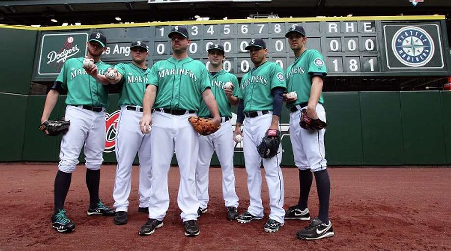 No-no-no-no-no-no-hitter: On June 8 at Safeco Field, six Mariners pitchers combined for a no-hitter against the L.A. Dodgers. From left to right: Charlie Furbush, Stephen Pryor, starter Kevin Millwood, Lucas Luetge, Brandon League and Tom Wilhelmsen put together just the 10th combined no-hitter in MLB history. It was the second of three no-hitters at Safeco Field in 2012.(Elaine Thompson / Associated Press) Photo: AP