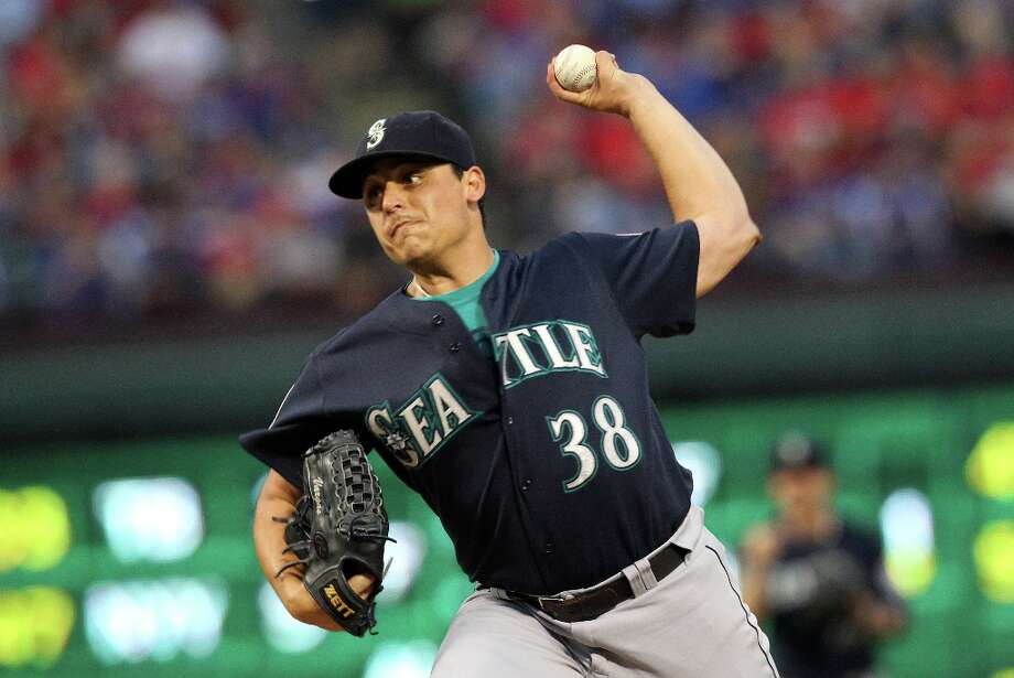 Pitchers of the month: Mariners starters Jason Vargas (pictured) and Felix Hernandez were each named the American League pitcher of the month. Vargas got it for July, when he went 5-1 in six starts with a 1.64 ERA. Hernandez got the honor for August, when he went 4-0 in five starts with an astounding 1.08 ERA and, of course, threw a perfect game Aug. 15 at Safeco Field. Photo: Layne Murdoch, Getty Images / 2012 Getty Images
