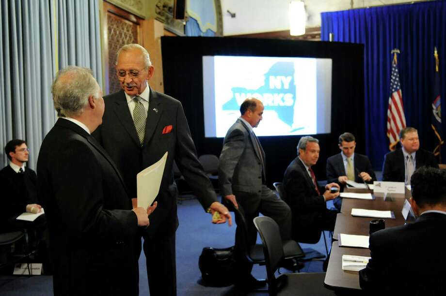 Herman Farrell, center, speaks with Denis Hughes, left, before the start of the members' meeting of the New York Works Task Force on Tuesday, Oct. 9, 2012, at the Capitol in Albany, N.Y. (Cindy Schultz / Times Union) Photo: Cindy Schultz / 00019585A