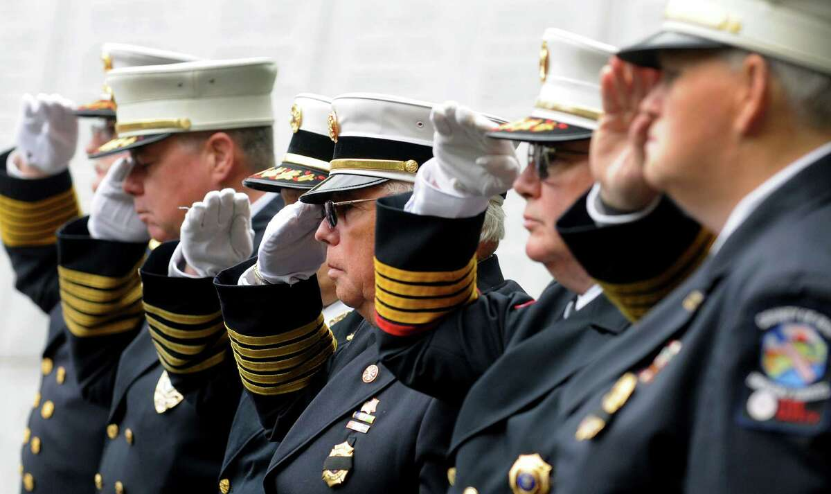 Fire officials salute during the New York State Fallen Firefighters Memorial Ceremony on Tuesday, Oct. 9, 2012, at the Empire State Plaza in Albany, N.Y. (Cindy Schultz / Times Union)