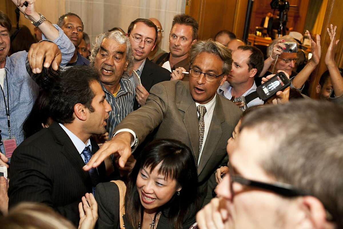 Sheriff Ross Mirkarimi greets supporters outside the hearing chambers after being reinstated by the Board of Supervisors in San Francisco, Calif., Tuesday, October 9, 2012.