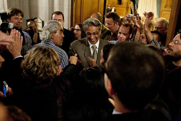 Sheriff Ross Mirkarimi greets supporters outside the hearing chambers after being reinstated by the Board of Supervisors in San Francisco, Calif., Tuesday, October 9, 2012. Photo: Jason Henry, Special To The Chronicle