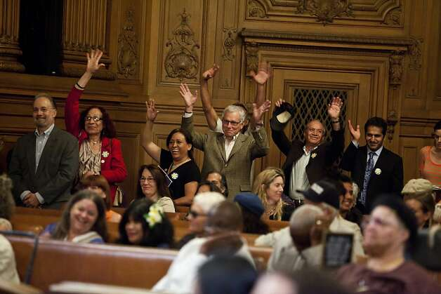 Supporters of Ross Mirkarimi show their support for a public speaker by waving their hands rather than making noise under rules of the chamber of the Board of Supervisors during the ethics hearing for Mirkarimi at City Hall in San Francisco, Calif., Tuesday, October 9, 2012. Photo: Jason Henry, Special To The Chronicle