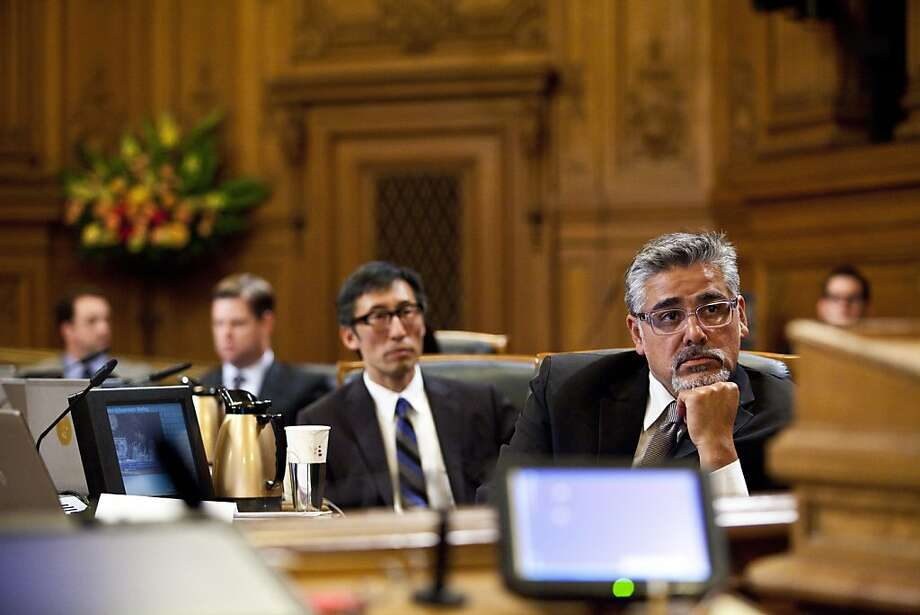 Supervisor John Avalos (right) introduced an ordinance to remove part of the Police Department's code that allows National Rifle Association membership. Photo: Jason Henry, Special To The Chronicle