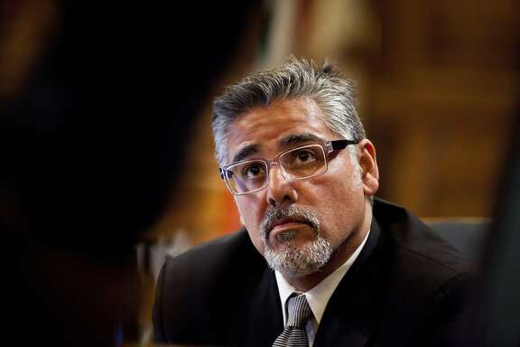 Supervisor John Avalos and other members of the Board listen to members of the public speak during the ethics hearing for Mirkarimi at City Hall in San Francisco, Calif., Tuesday, October 9, 2012.