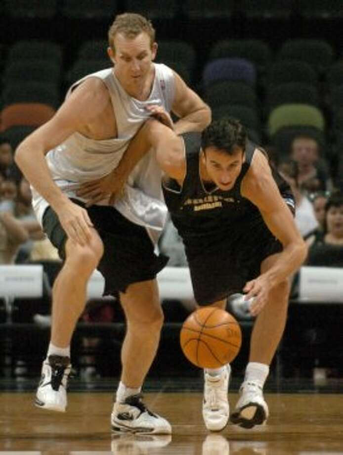 Spurs guard Manu Ginobili pushes back Sean Marks during early action at the Spurs Open Scrimmage at the SBC Center on Sunday, Oct. 10, 2004. (John Davenport / San Antonio Express-News)