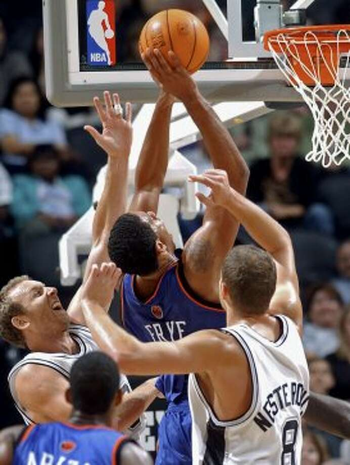 The Spurs' Sean Marks and Rasho Nesterovich can't stop the Knicks' Channing Frye from scoring in the second half on Saturday, Oct. 22, 2005, at the SBC Center.  (Tom Reel / San Antonio Express-News)