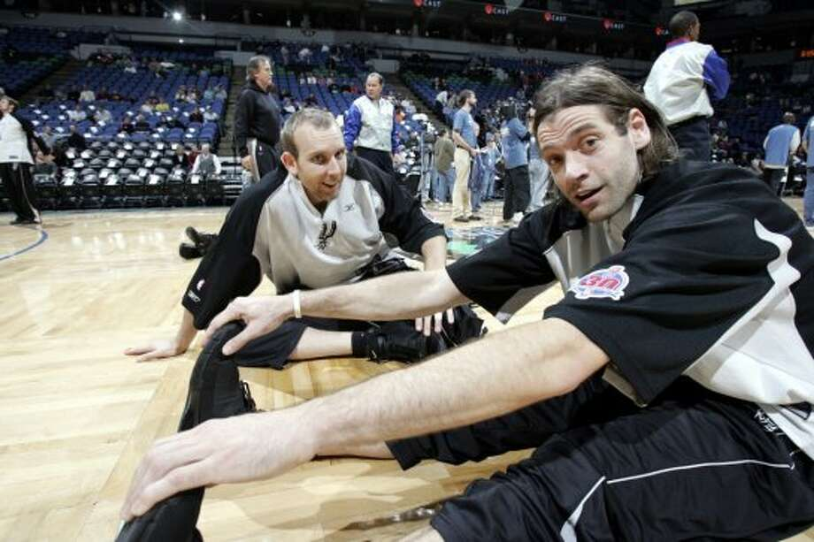 Fabrico Oberto #7 (right) and Sean Marks #40 of the Spurs stretch prior to a game against the Timberwolves on Dec. 15, 2005 at the Target Center in Minneapolis. (Melissa Majchrzak / NBAE via Getty Images)
