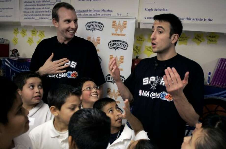 "Spurs players Manu Ginobili (right) and Sean Marks goof around with fifth-graders at Loma Park Elementary School on Monday, Jan. 23, 2006, after reading the students a book about an unlikely Olympic gold medalist. The players were invited to commemorate the ""What'cha Reading"" contest winner Joaquin Calderon, 11. (Mike Kane / San Antonio Express-News)"