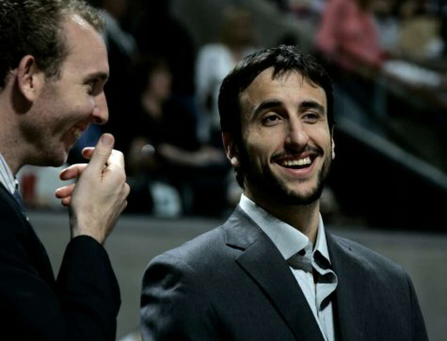 The Spurs' Manu Ginobili laughs with Sean Marks during the Spurs 83-81 victory over the Grizzlies on Sunday, April 9, 2006.  (Kevin Geil / San Antonio Express-News)