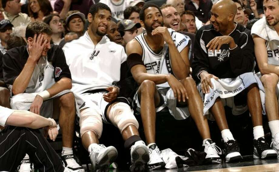 The Spurs enjoy the last minutes pf play on the bench against the Jazz Monday, April 17, 2006, in the second half. Spurs won 115-82 in front of a sell out crowd. (Gloria Ferniz / San Antonio Express-News)