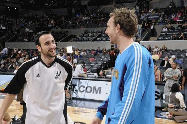 Manu Ginobili #20 of the San Antonio Spurs talks with Sean Marks #4 of the New Orleans Hornets prior to the game on Jan. 31, 2009, at the AT&T Center. The Spurs won 106-93.  (Clarke Evans / NBAE/Getty Images)