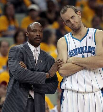 Hornets head coach Byron Scott and player Sean Marks stand near the sideline during Game Three of the Western Conference Quarterfinals against the Nuggets during the 2009 NBA Playoffs at New Orleans Arena on April 25, 2009, in New Orleans, La. (Bob Levey / Getty Images)