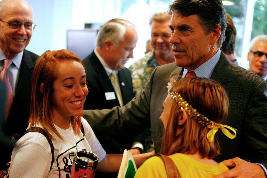 Texas Gov. Rick Perry meets with Angelo State University students Wednesday, Oct. 3, 2012 in San Angelo, Texas, after attending a press conference detailing a new $10,000 bachelor's degree plan that will go into affect in the fall of 2013. Nine other universities across the state have also come up with similar plans in response to a challenge given through the governor's office to create a bachelor's degree that costs no more than $10,000. (AP Photo/San Angelo Standard-Times, Patrick Dove) Photo: Patrick Dove, Associated Press / San Angelo Standard-Times