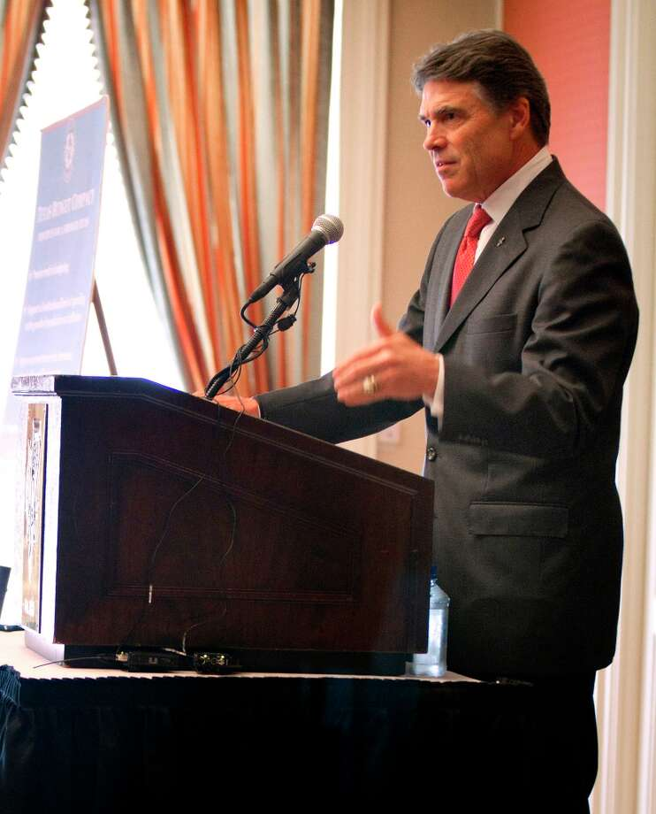 Gov. Rick Perry held a news conference at the Fort Worth Club to talk about the budget on Wednesday, Sept. 26, 2012 in Fort Worth, Texas. (AP Photo/Star-Telegram, Joyce Marshall) Photo: Joyce Marshall, Associated Press / Fort Worth Star-Telegram