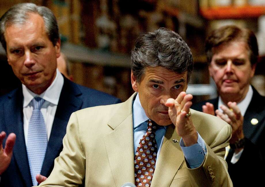 Gov. Rick Perry, center, flanked by Lt. Gov. David Dewhurst, left, and State Sen. Dan Patrick, R-Houston, right, answers questions during a news conference discussing the need for stricter spending limits in Texas on Tuesday, Sept. 25, 2012, in Houston. Photo: Brett Coomer, Houston Chronicle / © 2012 Houston Chronicle