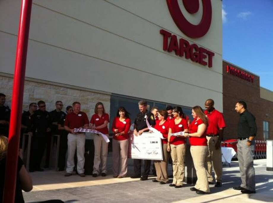 A ribbon-cutting ceremony marked the opening of a new 135,000-square-foot Target store in Terrell Heights on Tuesday, Oct. 9. San Antonio Police Chief William McManus accepted a $2,000 check for the Shop With A Cop program, which benefits needy children during the holidays.