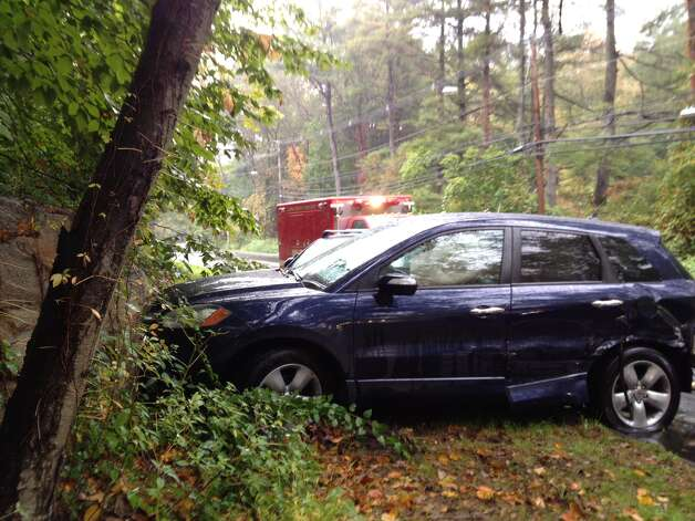 A four-car accident temporarily closed rain-slicked Long Ridge Road in Stamford at 8:40 a.m. Wednesday, Oct. 10, sending one New York man to the hospital. The New York driver in a  Chevrolet claims that he swerved to avoid a car turning out of Riverbank Road. The vehicle then struck a small SUV, which collided with a blue Honda Accura sending it into a large block of granite by the side of the road. Photo: The Advocate