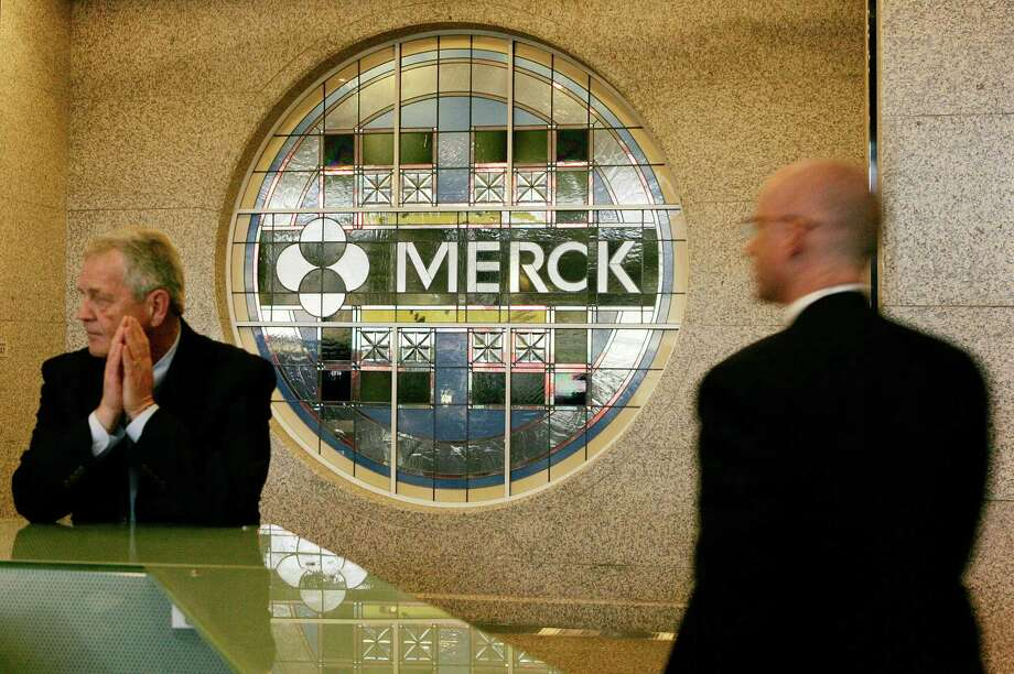 FILE - This Wednesday, April 15, 2009, file photo, shows the lobby of Merck & Company's world headquarters in Whitehouse Station, N.J. The drugmaker Merck & Co. announced Tuesday, Oct. 9, 2012, that it will move its global headquarters to another Merck site in Summit, which is about 12 miles west of New York City, in order tolower operating expenses and consolidate its properties. (AP Photo/Mel Evans) Photo: Mel Evans