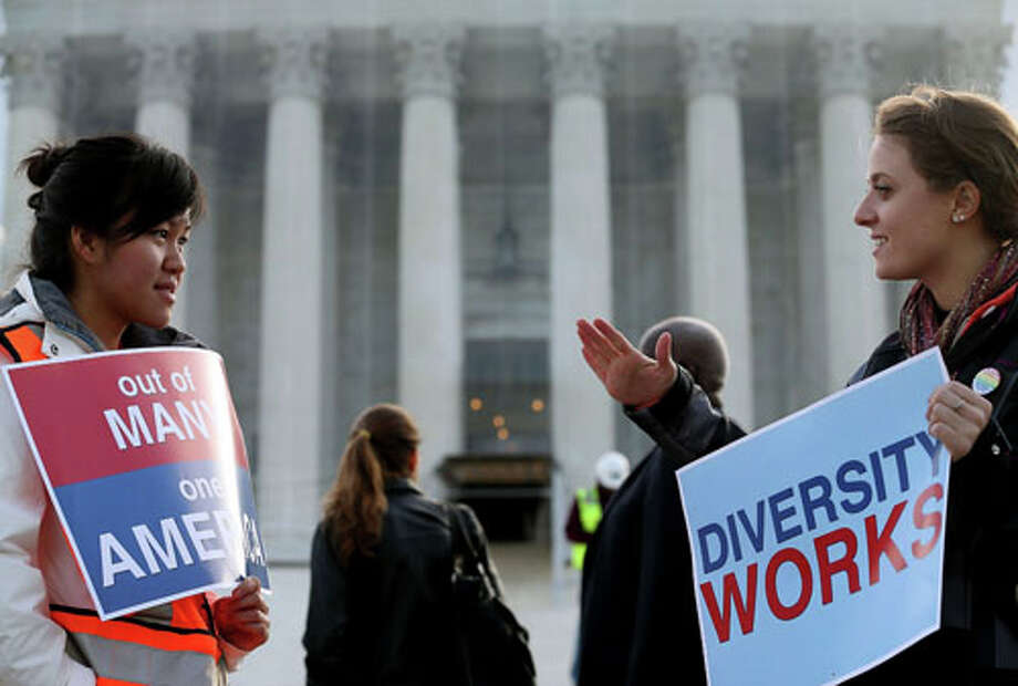 WASHINGTON, DC - OCTOBER 10: Helen Tran (L) and Jennifer Hicks protest in front of the U.S. Supreme Court on October 10, 2012 in Washington, DC. Today the high court is scheduled to hear arguments on Fisher V. University of Texas at Austin, and are tasked with ruling on whether the university's consideration of race in admissions is constitutional. Photo: Mark Wilson, . / 2012 Getty Images