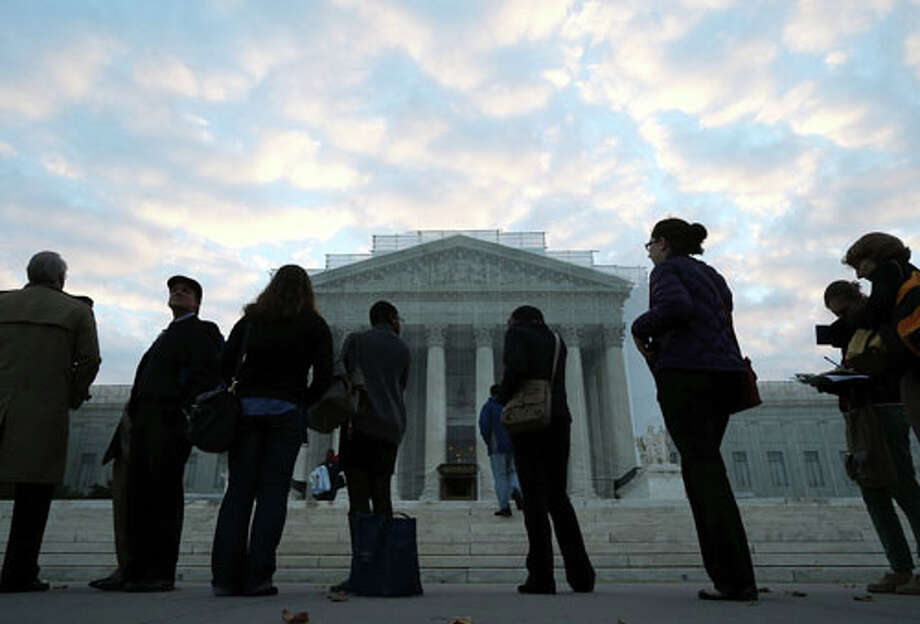 WASHINGTON, DC - OCTOBER 10:  People wait in line to enter the U.S. Supreme Court on October 10, 2012 in Washington, DC. Today the high court is scheduled to hear arguments on Fisher V. University of Texas at Austin, and are tasked with ruling on whether the university's consideration of race in admissions is constitutional. Photo: Mark Wilson, . / 2012 Getty Images