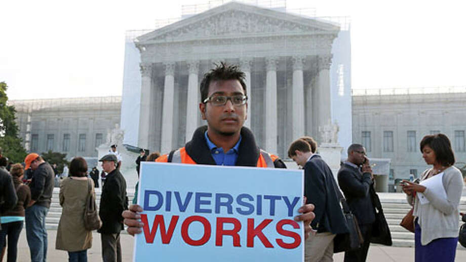 WASHINGTON, DC - OCTOBER 10: Travis Ballie holds a sign that reads (Diversity Works) in front of the U.S. Supreme Court on October 10, 2012 in Washington, DC. Today the high court is scheduled to hear arguments on Fisher v University of Texas at Austin, and are tasked with ruling on whether the university's consideration of race in admissions is constitutional. Photo: Mark Wilson, . / 2012 Getty Images