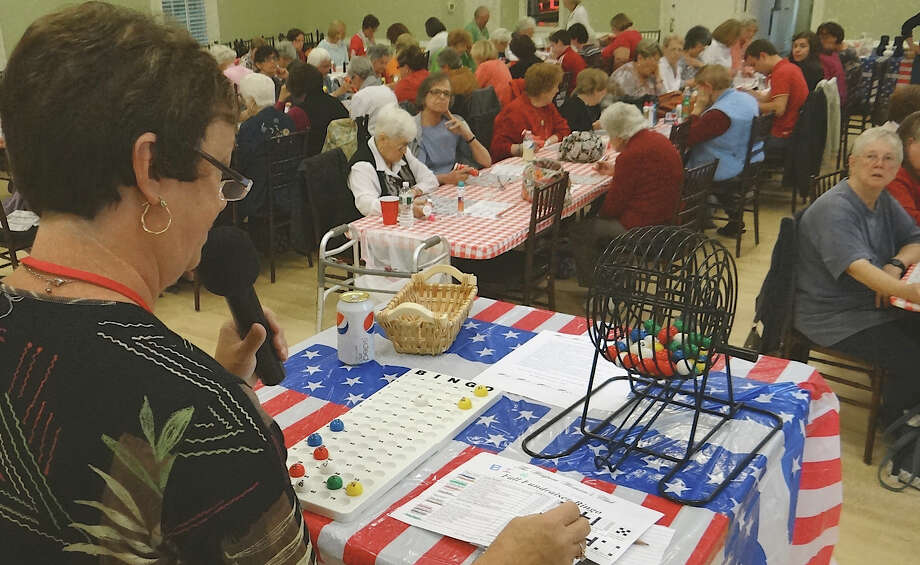 Wendy McKeon, the Westport Woman's Club's head of Scholarship Committee, running the club's Fall Bingo Fundraiser on Sunday afternoon. Photo: Mike Lauterborn / Westport News contributed