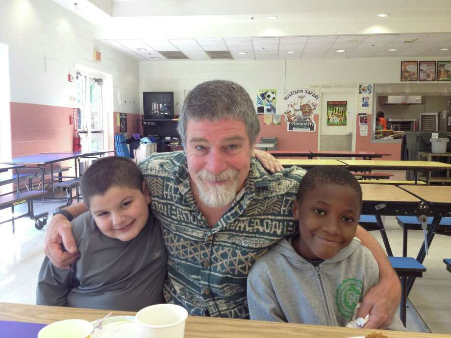 Mentor Robert McGrath, center, enjoys the Norwalk Mentor Program Breakfast last Wednesday with mentees Louis Gabriel, left, and Redly Wolfe. Photo: Contributed Photo