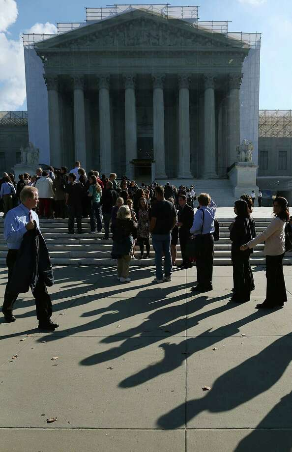 WASHINGTON, DC - OCTOBER 10:  People wait in line to enter the U.S. Supreme Court on October 10, 2012 in Washington, DC. The high court is scheduled to hear arguments on Fisher V. University of Texas at Austin and are tasked with ruling on whether the university's consideration of race in admissions is constitutional. Photo: Mark Wilson, Getty Images / 2012 Getty Images