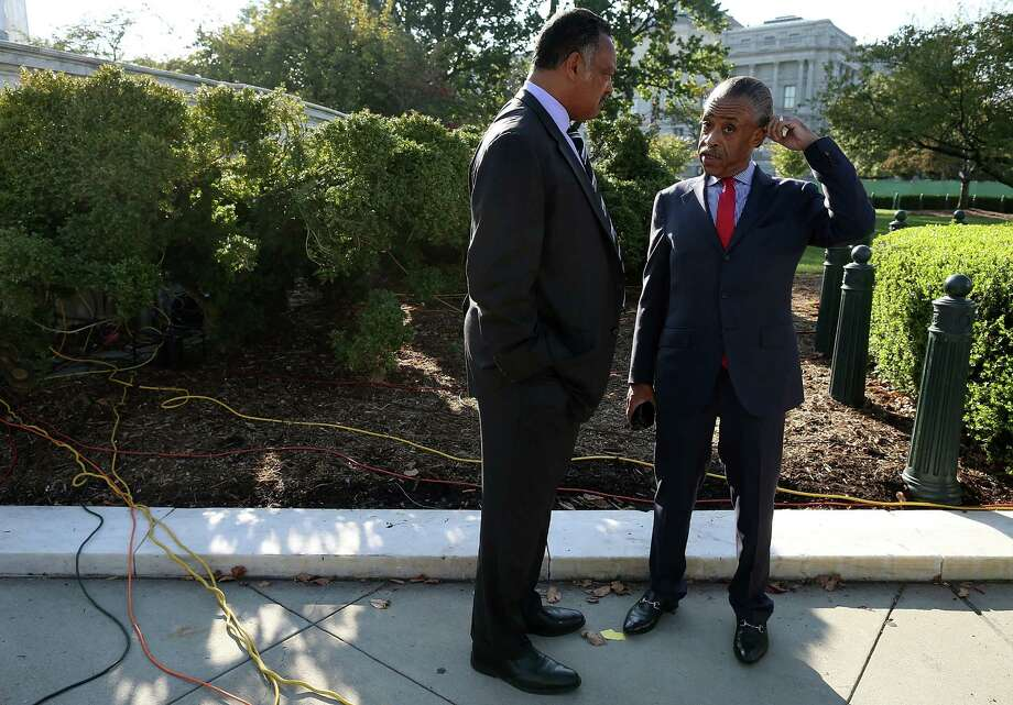 WASHINGTON, DC - OCTOBER 10:  Rev. Jesse Jackson (L) talks with Rev. Al Sharpton in front of the U.S. Supreme Court on October 10, 2012 in Washington, DC. The high court is scheduled to hear arguments on Fisher V. University of Texas at Austin and are tasked with ruling on whether the university's consideration of race in admissions is constitutional. Photo: Mark Wilson, Getty Images / 2012 Getty Images
