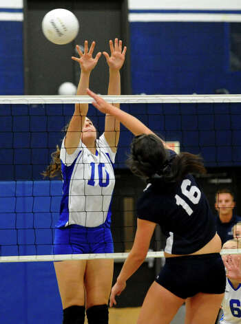 Darien's #10 Taylor Cockerill, left, goes to block Staples #16 Jennifer Dimitrief, during girls volleyball action in Westport,Conn. on Tuesday October 9, 2012. Photo: Christian Abraham / Connecticut Post