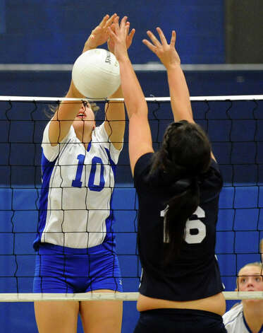 Darien's #10 Taylor Cockerill, left, and Staples #16 Jennifer Dimitrief, both reach the ball at the net, during girls volleyball action in Westport,Conn. on Tuesday October 9, 2012. Photo: Christian Abraham / Connecticut Post