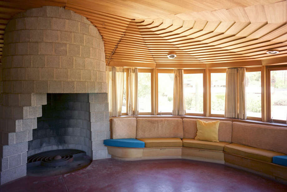 The intricate woodwork in the ceiling blends with the circular concrete fireplace (Photo by Scott Jarson  / savethewrighthouse.org)