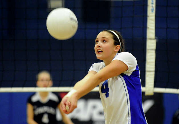 Darien's #4 Lauren Pryor bumps the ball, during girls volleyball action against Staples in Westport,Conn. on Tuesday October 9, 2012. Photo: Christian Abraham / Connecticut Post