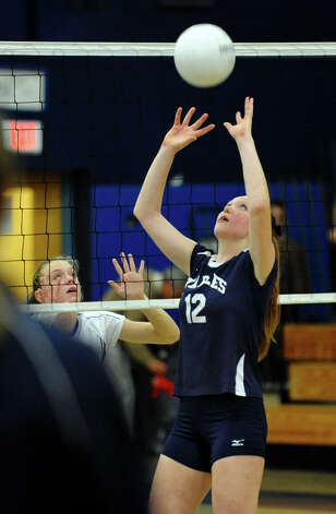 Staples #12 Francesca Lynch sets the ball for a teammate, during girls volleyball action against Darien in Westport,Conn. on Tuesday October 9, 2012. Photo: Christian Abraham / Connecticut Post