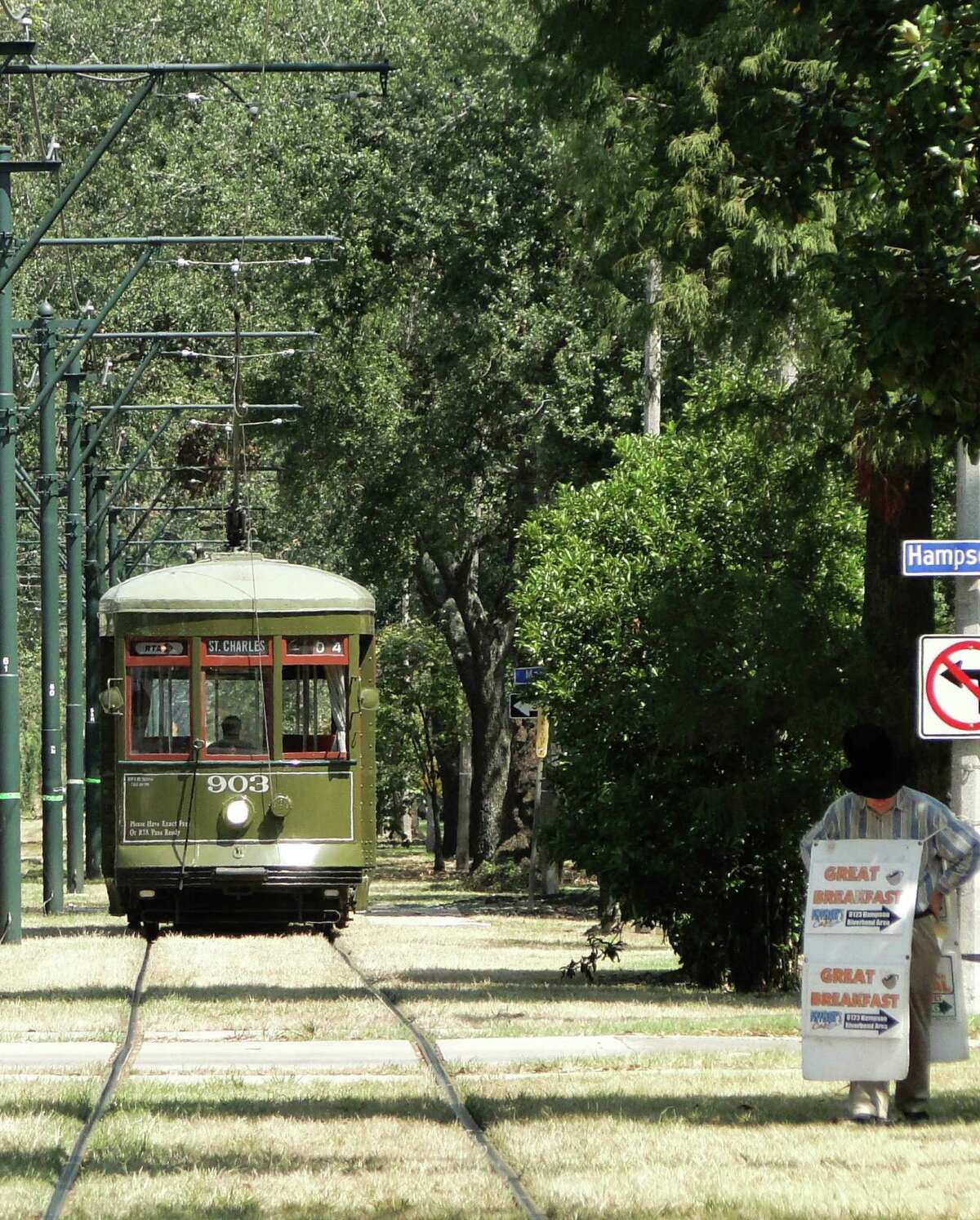 Riding the St. Charles streetcar is an easy way to sightsee in the Garden District of New Orleans.