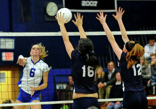 Darien's #6 Kelly Kosnik tries to get the ball past Staples players #16 Jennifer Dimitrief, center, and #12 Francesca Lynch, right, during girls volleyball action in Westport,Conn. on Tuesday October 9, 2012. Photo: Christian Abraham / Connecticut Post