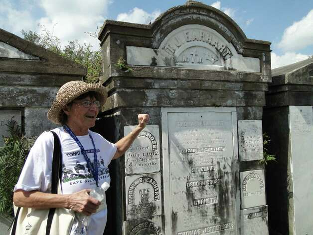 Gayl Pearson, a Save Our Cemeteries tour guide, explains the history and traditions in above-ground tombs in Lafayette Cemetery at Prytania and Washington streets in New Orleans. Photo: Tracy Hobson Lehmann, San Antonio Express-News