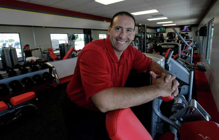 In this June 14, 2012, photo, Rick Limitone, manager of Snap Fitness, posses for a photo at the truck stop gym in Dallas. From trucking companies embracing wellness and weight-loss programs to gyms being installed at truck stops, momentum has picked up in recent years to help those who make their living driving big rigs get into shape. (AP Photo/LM Otero) Photo: LM Otero, STF / AP
