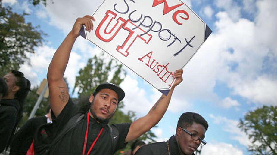 "WASHINGTON, DC - OCTOBER 10: Leon Wheeler holds a sign that reads ""We Support U.T. Austion"" during a rally in front of the U.S. Supreme Court Supreme, on October 10, 2012 in Washington, DC. The high court is scheduled to hear arguments on Fisher V. University of Texas at Austin and are tasked with ruling on whether the university's consideration of race in admissions is constitutional. Photo: Mark Wilson, . / 2012 Getty Images"
