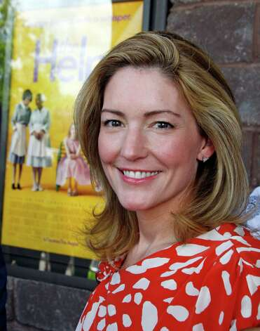 "Author Kathryn Stockett  poses by a poster  for the movie made from her book prior to a benefit screening of ""The Help"" in Madison, Miss., Saturday, July 30, 2011.  The film is based on the New York Times best-selling book by Stockett about the lives of three women in the 1960s Mississippi. (AP Photo/Rogelio V. Solis) Photo: Rogelio V. Solis, STF / AP2011"