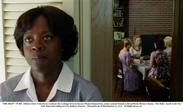 """THE HELP"" - Aibileen Clark (Viola Davis) overhears the exchange between Skeeter Phelan (Emma Stone, center) and her friends in DreamWorks Pictures' drama, ""The Help"", based on the New York Times best-selling novel by Kathryn Stockett. DreamWorks II Distribution Co., LLC.  All Rights Reserved. / ©DreamWorks II Distribution Co., LLC.  All Rights Reserved."