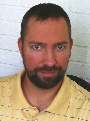 Jesse Osmun, a former Peace Corps volunteer from Milford, charged with abusing several young girls in a South African HIV/AID encampment preschool, was sentenced to 15 years in federal prison on Wednesday, Oct. 10, 2012. Photo: Contributed Photo, ST