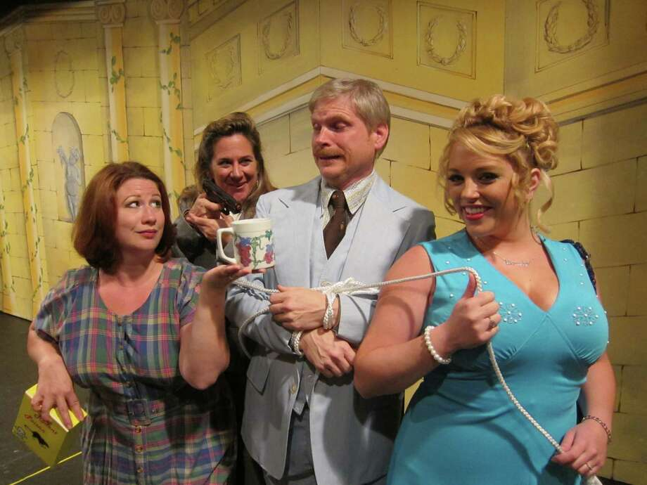 Franklin Hart Jr. of  the musical, film and TV show '9 to 5' is a sleazy boss. Pictured: Amy-Lin Slezak-Nelson as Violet Newstead, Karen Kolterman as Judy Bernly, John Sutliff as Franklin Hart, Jr., Molly McGrath as Doralee Rhodes in Home Made Theater's '9 to 5.' (Home Made Theater)