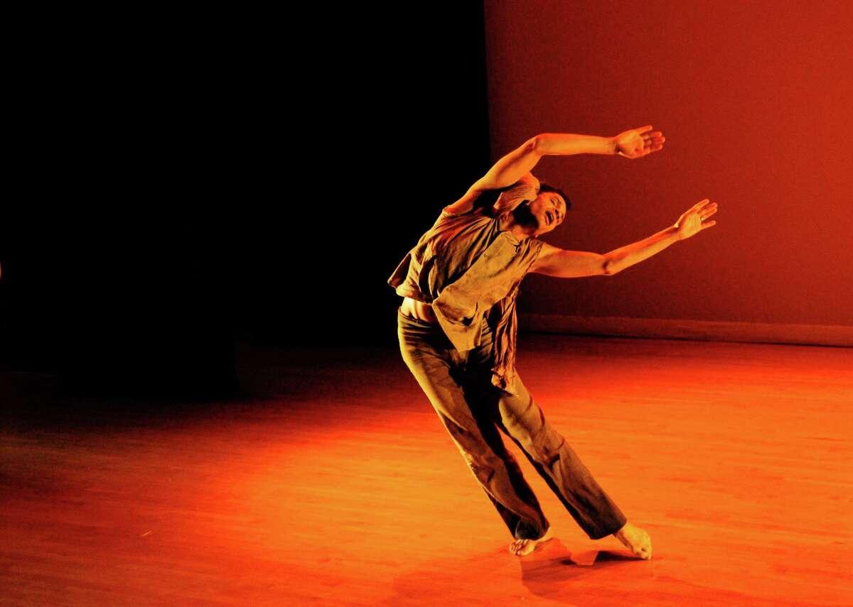 Adam McKinney dances in