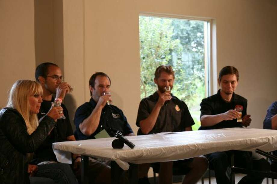Christine Celis of Celis Brewery, Brian Royo of No Label Brewing, Kevin Brand of (512) Brewing, Michael Graham of Austin Beerworks and Wim Bens of Lakewood Brewing taste a featured beer during a panel discussion on the future of the Texas craft beer industry at the Texas Craft Brewers Festival. (Markus Haas / San Antonio Express-News)
