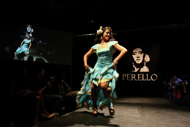 Daniella Espinoza, 16, shows her style and Perello's  flamenco costume  during the Perello All Flamenco Fashion Show.