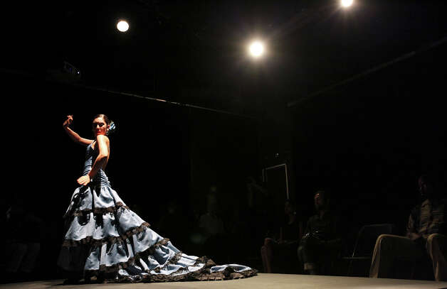Monica Moncivais, 31, models a flamenco costume by Lisa Perello at the recent  Perello All Flamenco Fashion Show  at Say Sí Theater. Photo: Edward A. Ornelas, San Antonio Express-News / © 2012 San Antonio Express-News