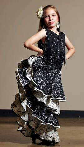 Emily Limon, 9, models a Perello design during the Perello All Flamenco Fashion Show last month. Photo: Edward A. Ornelas, San Antonio Express-News / © 2012 San Antonio Express-News