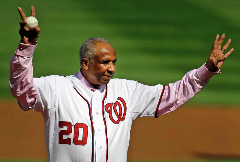 Former Washington Nationals manager Frank Robinson acknowledges fans before throwing out the ceremon